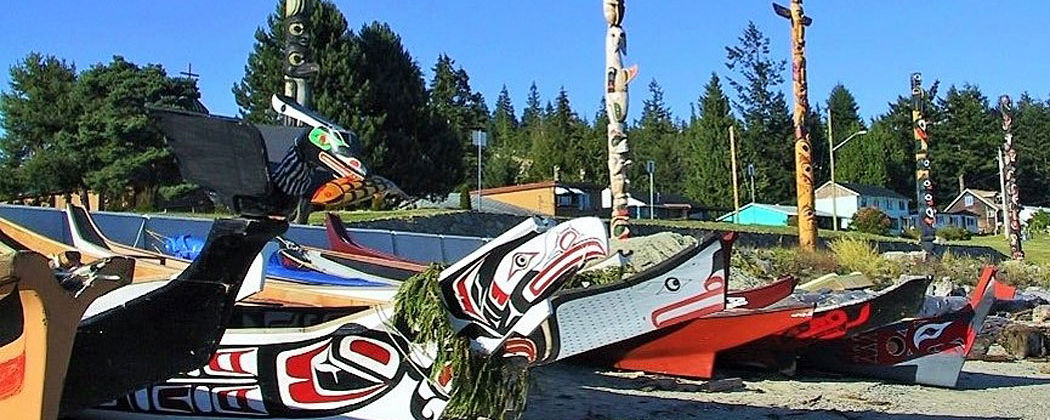 canoes and totems, credit Talaysay Tours