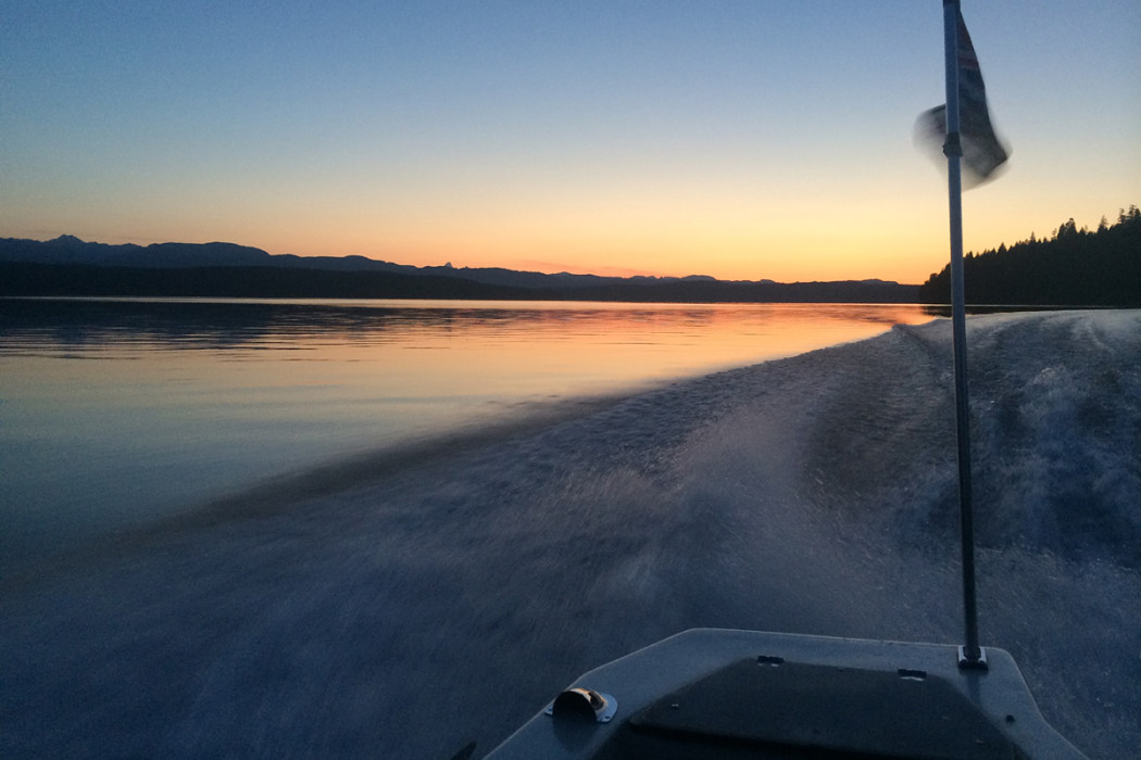 Sunset and boat ride at McIvor Lake British Columbia coast